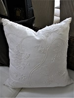 White embroidered cushion