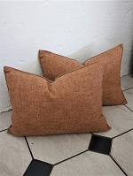 Pair of light rust new cushions