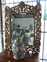 Carved wood framed mirror